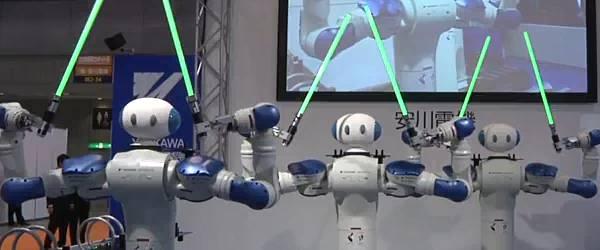 IREX 2009 : La danse des Robots Motoman avec les sabres laser.