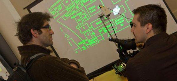 Un contrôleur 3D multipoints à base de gants et d'une caméra.