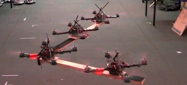 Vidéo : Utiliser et synchroniser plusieurs Quadrirotors pour le transport de charge