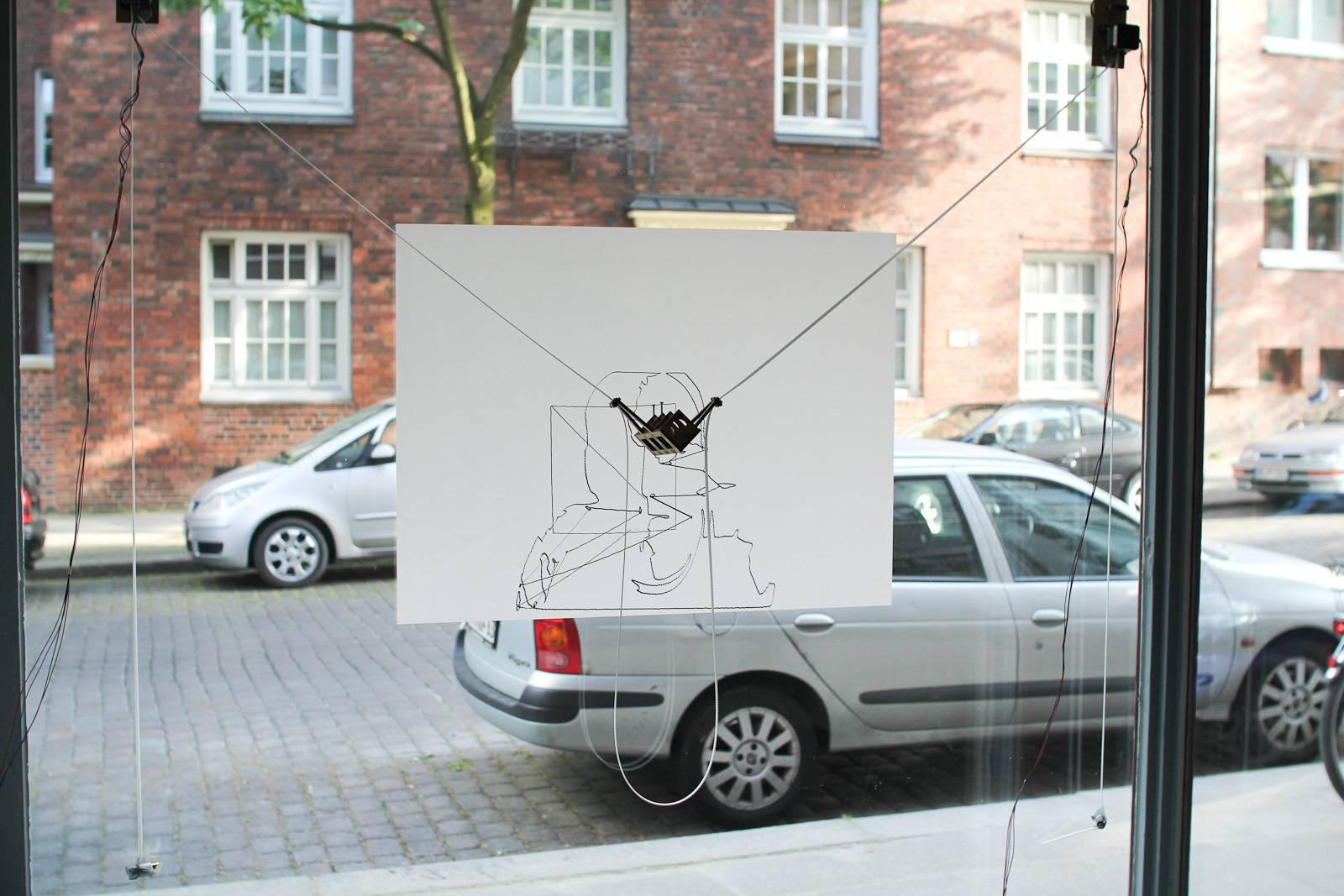 der kritzler la machine qui dessine sur les vitres semageek. Black Bedroom Furniture Sets. Home Design Ideas